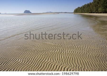 Sand ridges on Rajamangala beach, Trang Province, Thailand - stock photo