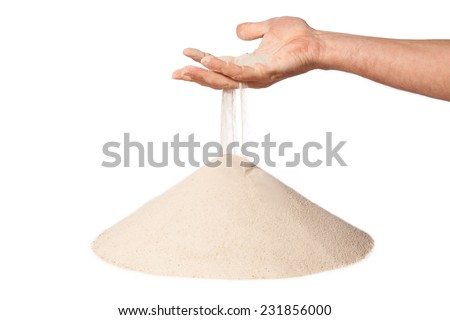 sand running through hand as a symbol for time running out. Isolated on a white background - stock photo
