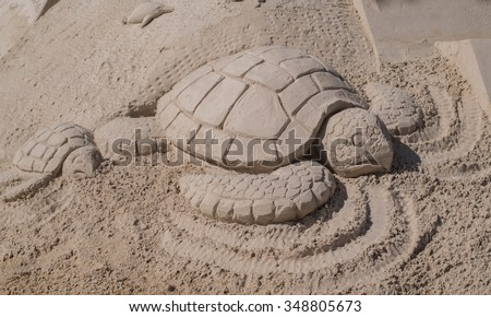 Sand sculpture mother sea turtle her stock photo royalty free sand sculpture of a mother sea turtle and her baby sea turtle on fort myers beach publicscrutiny Gallery