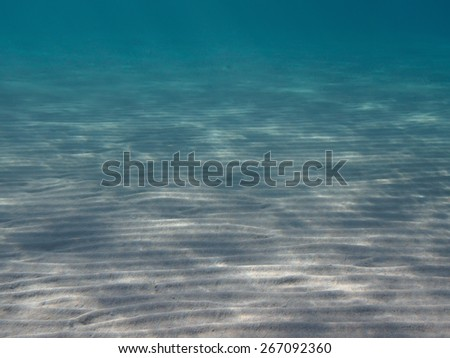 Sand sea bottom and clear blue water, underwater tropical paradise background - stock photo
