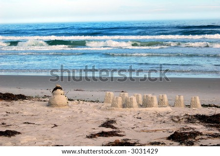 Sand snowman on the beach