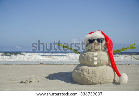 Sand Snowman Ready for Holiday Card. Use for Christmas, New Year's, Tropical Vacation or Holiday Card.