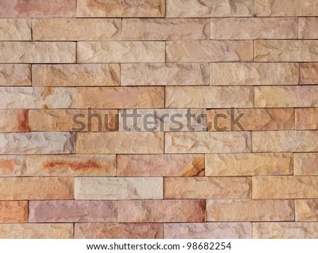 Sand stone brick wall - stock photo