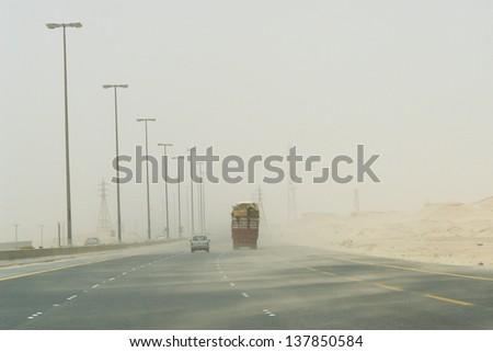 Sand storm in desert road -  Photo taken near to Iraq and Kuwait border - stock photo