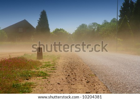 Sand storm on a sunny day. - stock photo