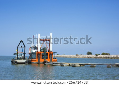 Sand sucking ship  - stock photo