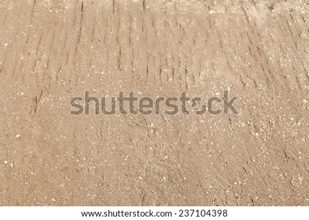 Sand surface with rocks and stones - stock photo