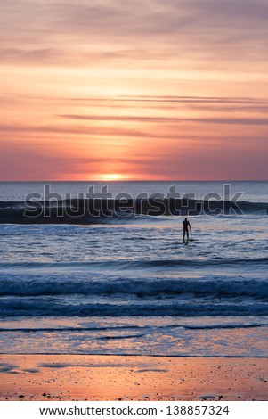 Sand surfer at sunset