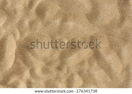 Sand Texture -Closeup of sand pattern of a beach in the summer - stock photo