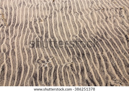 Sand texture with patterns formed by the wind at Flag Ponds Nature Park at the shores of the Chesapeake Bay in Southern Maryland. - stock photo