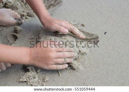 sand therapy. Hands adult and child playing in the sand