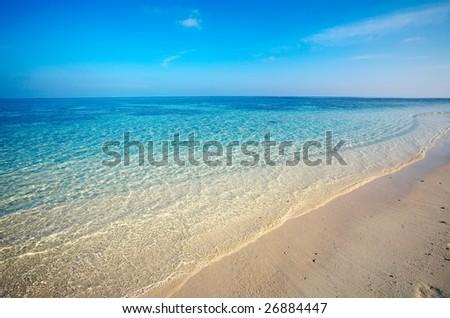Sand tropical beach on uninhabited island, Maldives - stock photo