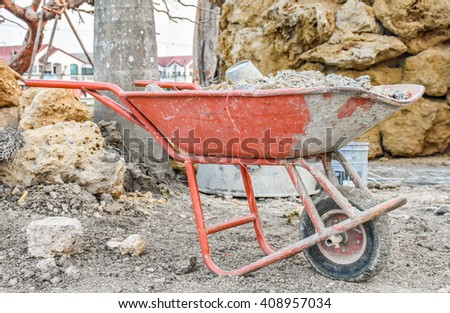 sand truck at a construction site. - stock photo