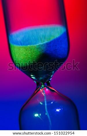sand watch macro closeup flow colorful - stock photo