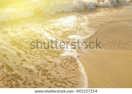 Sand with sun yellow beam light of beach  shore with sea wave cozy background - stock photo