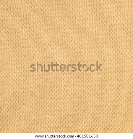 Sand yellow wool knitted fabric texture. Close up fragment of the top view.