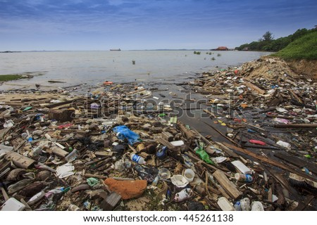 SANDAKAN, MALAYSIA - CIRCA JUNE 2016: Pollution environmental problem. Water pollution due to plastic bags and bottles and pther rubbish thrown directly into the sea and washing up on beach. - stock photo