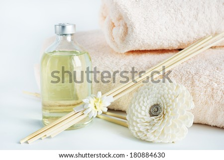 Sandal oil and towels for spa procedures - stock photo