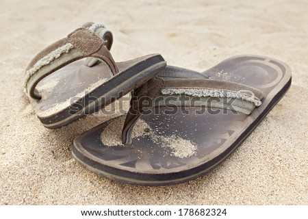 sandals on the beach. - stock photo