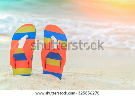 sandals on white sand - stock photo