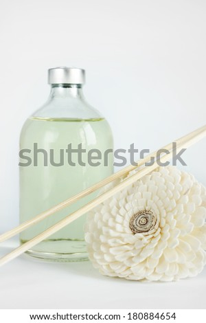 Sandalwood oil in a glass bottle and sticks for spa procedures - stock photo