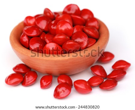 Sandalwood Seeds in a brown bowl over white background - stock photo