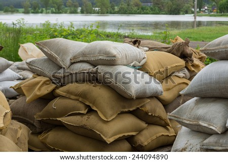 Sandbags to fight against the floodwater - stock photo