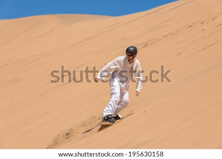 Sandboarder in action, Africa, Namibia - stock photo