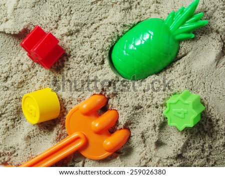 Sandbox and multicolored toys closeup.  - stock photo