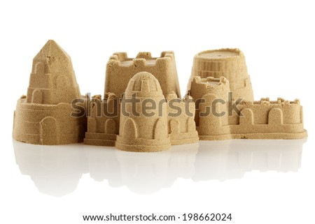 Sandcastle at the beach isolated over white  - stock photo