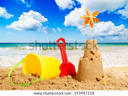 Sandcastles at the beach with bucket and spade - stock photo