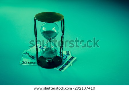 sandglass and eur banknote image - stock photo
