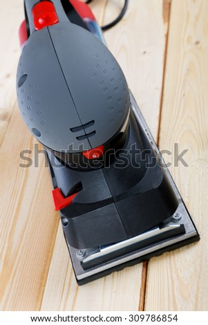 sanding machine on the boards close-up - stock photo