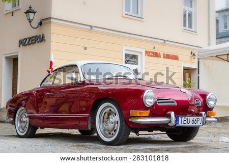 SANDOMIERZ, POLAND - MAY 03: The two-door coupe Volkswagen Karmann Ghia front in Sandomierz, Poland on May 03, 2015.