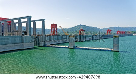 SANDOUPING, CHINA - April 15, 2016: The Three Gorges Dam spans the Yangtze River in Sandouping, Yichang, Hubei, China. It is the largest hydro-electric power station in the world. - stock photo