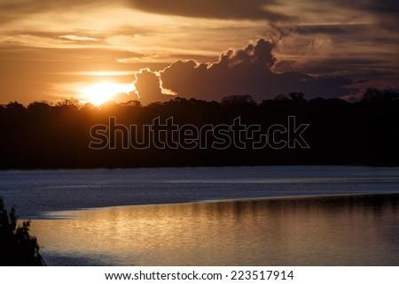 SANDOVAL LAKE, TAMBOPATA, PERU: Dawn in the amazon jungle - stock photo