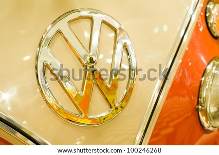 SANDOWN PARK, UK - MARCH 26: Iconic VW name badge on the hood of a pristine Volkswagen Camper at the Volksworld Show, on March 26, 2011 in Sandown Park, UK - stock photo
