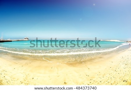 sands and waterfront at sunset public beach in Dubai UAE panoramic travel vacations scene background detail exterior normalized fisheye wide view