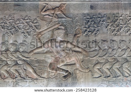 sandstone carvings depicting the churning of the sea of milk on the walls of Angkor Wat near Siem Reap Cambodia