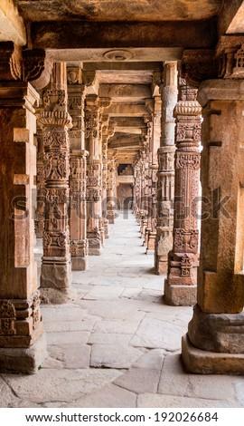 Sandstone columns at Qutab Minar, Delhi, India - stock photo