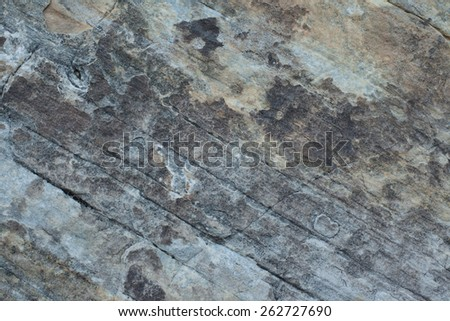 Sandstone Desert Rock Texture - Dark Grey, Blue and Yellow - stock photo