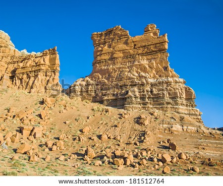 Sandstone formations rise from the desert at Molly's Castle near Utah's Goblin Valley State Park. - stock photo