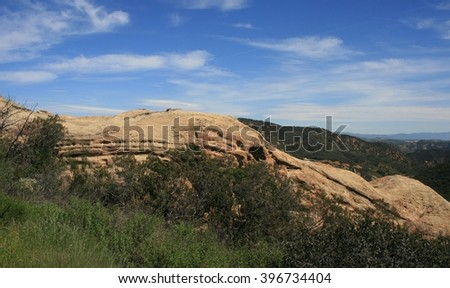 Sandstone geology with blue sky and clouds, Malibu, CA - stock photo