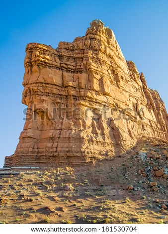 Sandstone glows golden in evening light at Molly's Castle, a rock outcropping in the Utah desert.