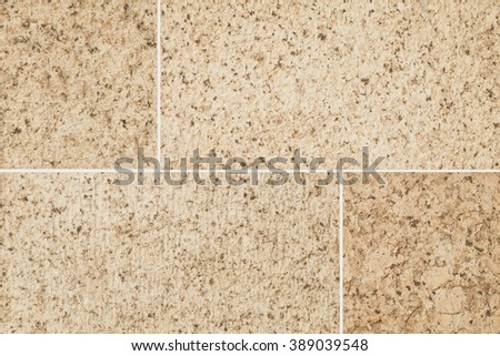 Sandstone tile wall texture and background - stock photo