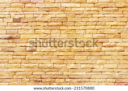 Sandstone wall background,Pattern of Sandstone Brick Wall Surfaced - stock photo