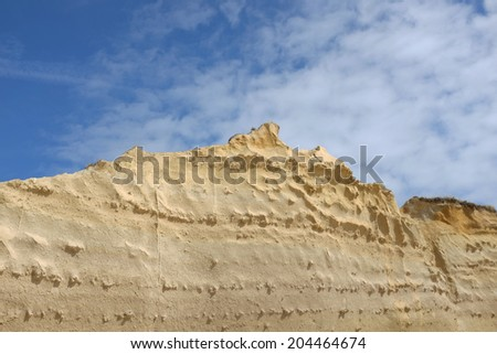 Sandstone wall down at the beach. Meco, Sesimbra, Portugal.  - stock photo