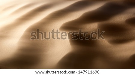 Sandstorm in desert -  dunes in the wind - stock photo