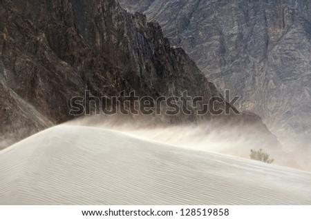 Sandstorm in desert in Nubra valley in Ladakh, India - stock photo