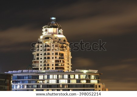 SANDTON, SOUTH AFRICA - March 12, 2016: Closeup view of  the Michelangelo Towers, photographed against a dark sky. The Michelangelo Towers house the upmarket Michelangelo Hotel and apartments. - stock photo